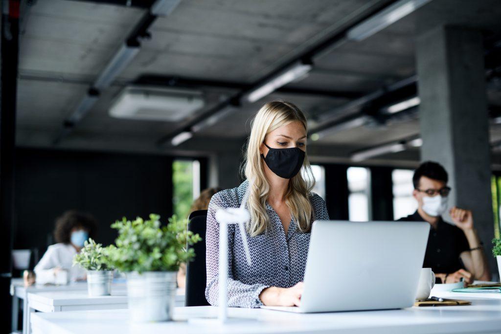 Office Workers with face masks back at work